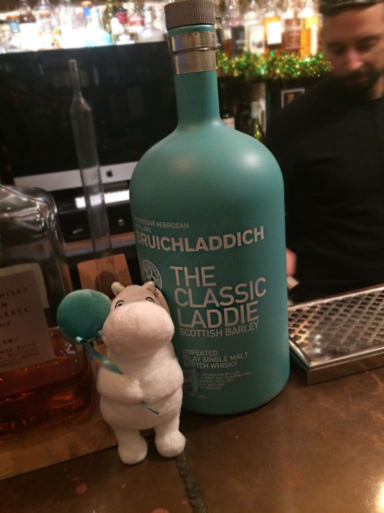 moomin toy next to bottle of whisky
