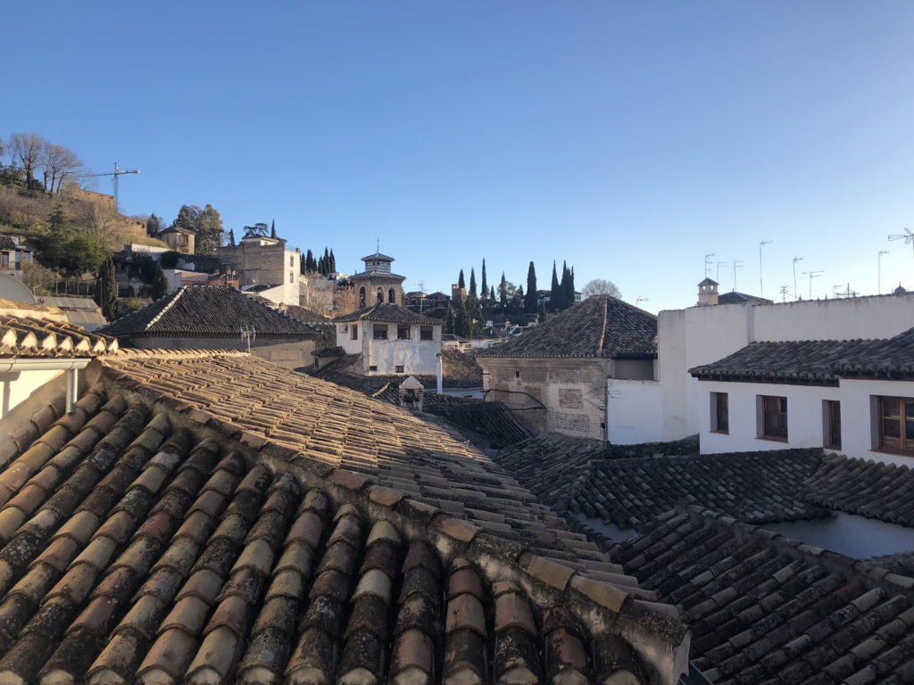 View of blue sky and rooftops in Granada Spain