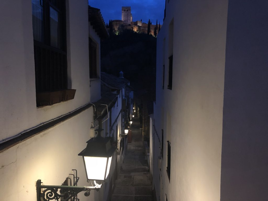 view of the Alhambra through a romantic alley on the way for tapas