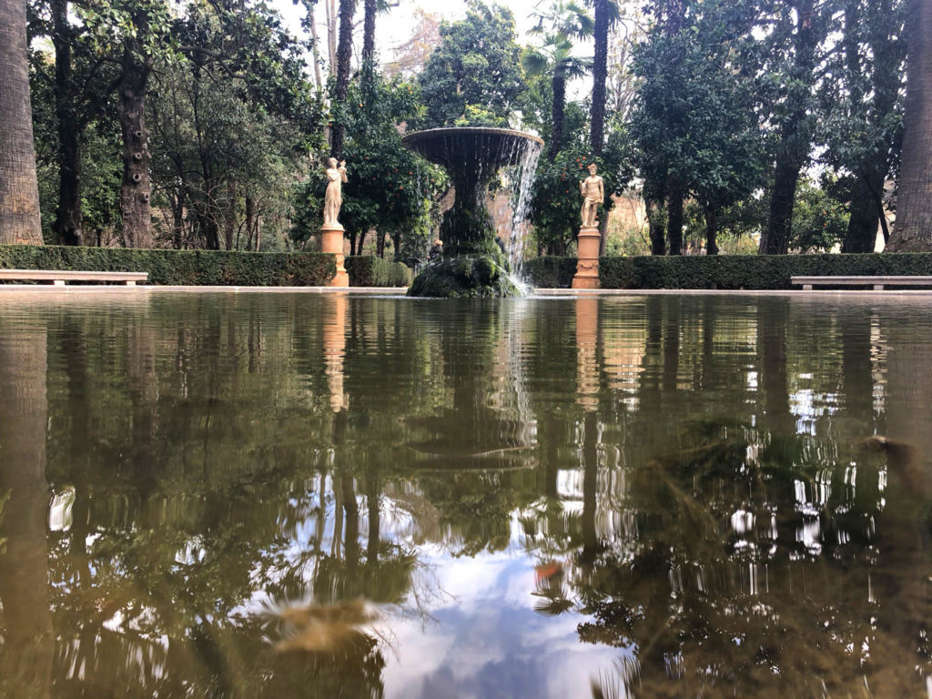 fountain of Carmen de los martires gardens looks over pond