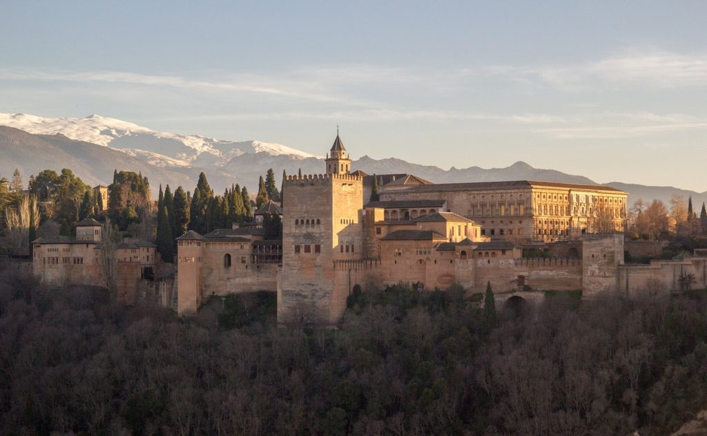 View of Alhambra Palace with Sierra Nevada Mountains in the background Granada, Spain
