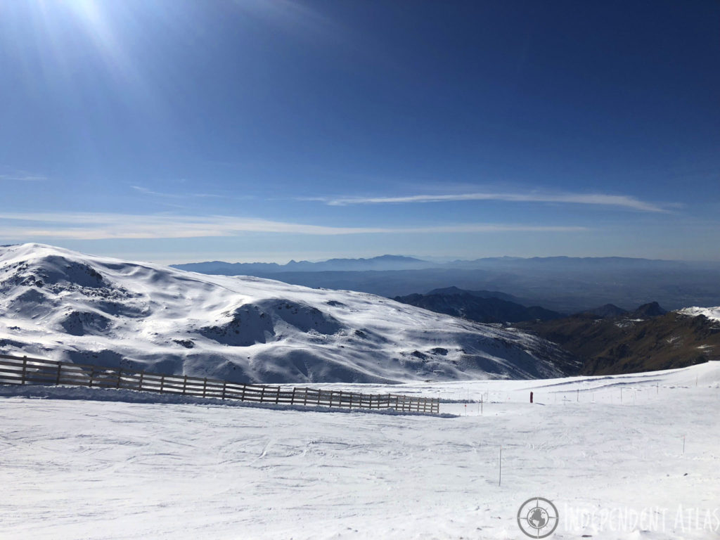 snowboarding in spain, skiing in spain, snowboarding the sierra nevada mountains, snow, sun, blue skies, slope