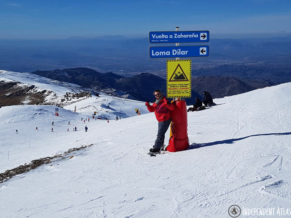 snowboarding in spain, skiing in spain, snowboarding the sierra nevada mountains, snow, sun, blue skies, thumbs up