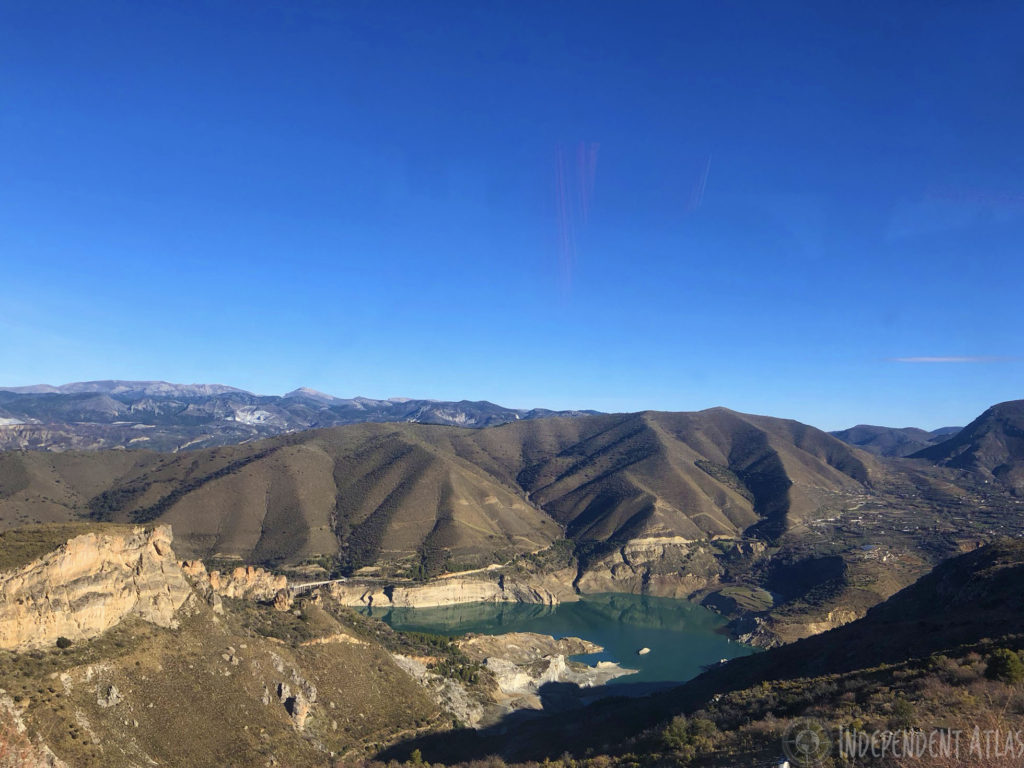 snowboarding in spain, skiing in spain, snowboarding the sierra nevada mountains, lake on the drive up