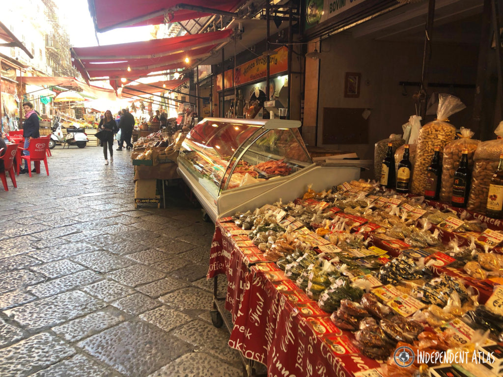 All kind of food and reserves set out on market stallas as you look down the street, Palermo street food, Street food in Palermo