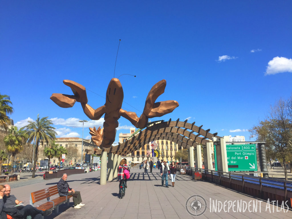 A day in Barcelona, Giant smiling lobster in Barceloneta Harbour with palm trees and a promenade below