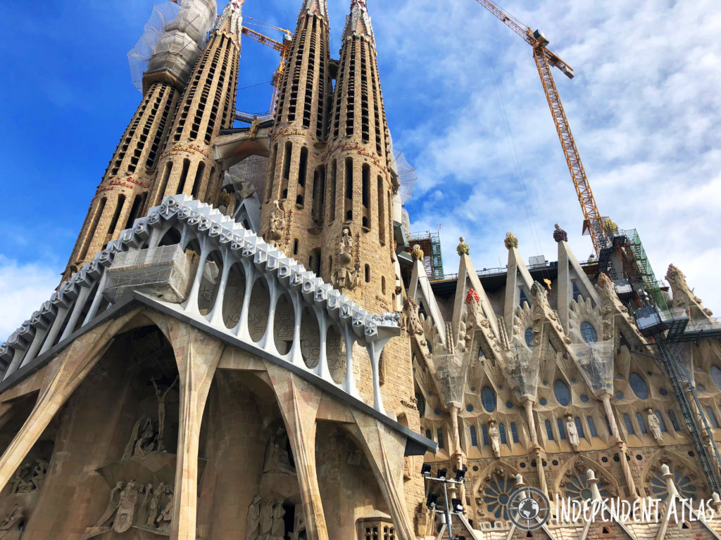 A day in Barcelona, View of the front of Sagrada Familia with crane overhead
