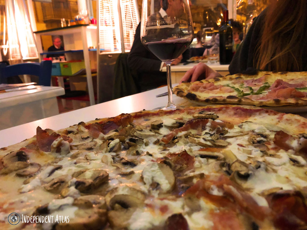 Cheesey pizza with a glass of wine in a trattoria, Palermo street food, Street food in Palermo,